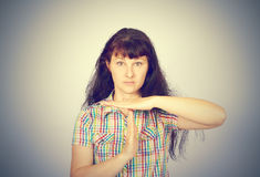 Young serious woman showing time out gesture with hands Royalty Free Stock Photography