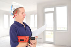 Young serious worker with drill Royalty Free Stock Photo