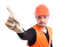 Young serious workman making refusal sign. With his finger on white background as warning concept Stock Photo