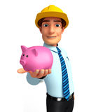 Young Service Man with piggy bank Royalty Free Stock Image