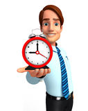 Young Service Man with table clock Stock Photos