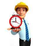 Young Service Man with table clock Royalty Free Stock Photo