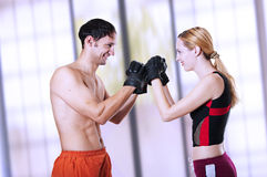 Young sexual couple fighters smiling Stock Images