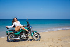 Young, sexual, the girl on the motorcycle, on a beach Royalty Free Stock Photos