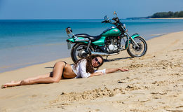 Young, sexual, the girl on the motorcycle, on a beach Stock Image