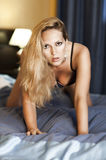 Young sexual woman on bed Stock Image