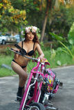 Young sexy Asian woman in black lingerie on pink motorcycle Royalty Free Stock Photography