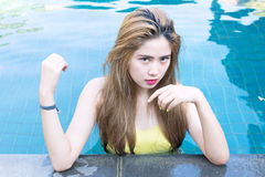 Young sexy asian woman posing in pool Royalty Free Stock Photos