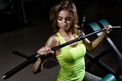 Young athlete girl lifts in the gym stock photography