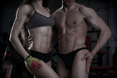 Young sexy athletic man and woman after fitness exercise. Perfect muscular body Royalty Free Stock Photography