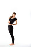 Young sexy athletic woman in black sportswear full-length - isol Royalty Free Stock Image