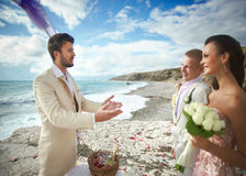 Young, sexy and attractive couple listening preacher speech duri Stock Images
