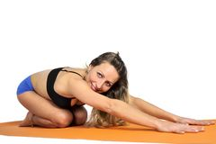 Young sexy attractive fit woman at gym doing yoga exercise and position sitting on mat in meditation and relax Stock Photography