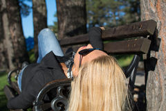 Young sexy beautiful girl in a park with long blond hair. Young sexy attractive business woman with long blonde hair in a park Royalty Free Stock Photography