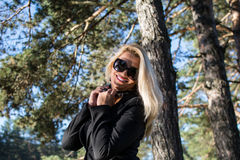 Young sexy beautiful girl in a park with long blond hair. Young sexy attractive business woman with long blonde hair in a park Royalty Free Stock Images