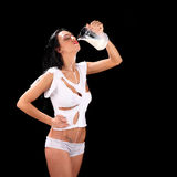 Young sexy beautiful woman with milk, isolated on black Stock Photos