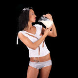 Young sexy beautiful woman with milk, isolated on black. Studio Royalty Free Stock Image
