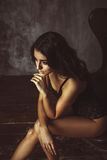 Young Sexy Beautiful Woman Sitting On Chair Royalty Free Stock Photos