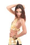 Young sexy bikini model in gold Stock Photos