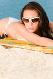 Young sexy bikini model relaxing with sunglasses Stock Images