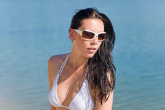 Young sexy bikini model with white sunglasses Stock Photo