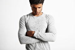 Young sexy black model wearing light gray longsleeve t-shirt Stock Images