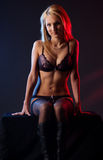 A young and sexy blond in black erotic lingerie Stock Photography
