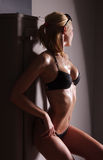 A young and sexy blond in black erotic lingerie Royalty Free Stock Photo