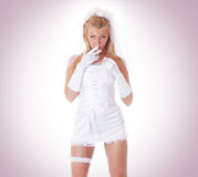 A young and sexy blond bride in erotic clothes Royalty Free Stock Photo