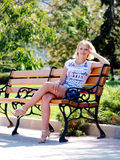 Young sexy blond girl in summer park Stock Photo