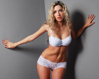 A young and sexy blond in white erotic lingerie Royalty Free Stock Images
