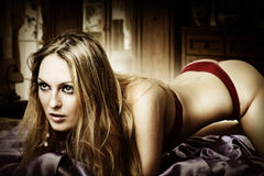 Young sexy blond woman at bedroom Stock Photos