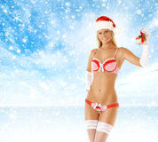 A young and sexy blond woman in Christmas lingerie Royalty Free Stock Photos