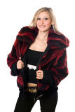 Young sexy blond woman in a fur jacket. Isolated Stock Images