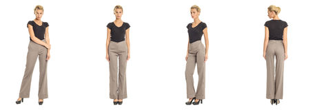 Young sexy blond woman in gray trousers isolated. Young sexy blond woman in gray trousers Royalty Free Stock Image