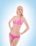 A young and sexy blond woman in pink lingerie Royalty Free Stock Photography