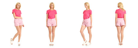 Young sexy blond woman in pink shorts isolated Stock Image