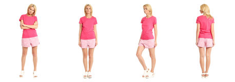 Young sexy blond woman in pink shorts isolated Stock Images
