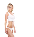A young and sexy blond woman posing in white lingerie Royalty Free Stock Photography