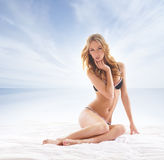 Young and sexy blond woman relaxing on the beach Stock Photo