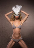 A young and sexy blond woman in a white mask Royalty Free Stock Image