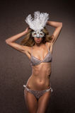 A young and sexy blond woman in a white mask Royalty Free Stock Photo