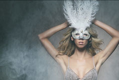 A young and sexy blond woman in a white mask Royalty Free Stock Images