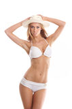 A young and sexy blond woman in a white swimsuit Stock Photo