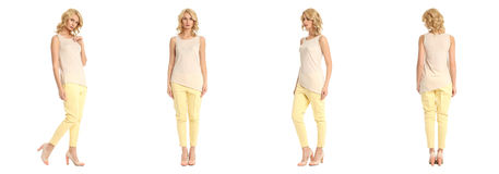 Young sexy blond woman in yellow trousers isolated. Young sexy blond woman in yellow trousers Royalty Free Stock Image