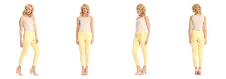 Young sexy blond woman in yellow trousers isolated. Young sexy blond woman in yellow trousers Royalty Free Stock Photography