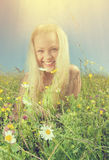 Young blonde with camomile royalty free stock image