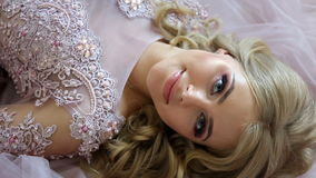Young sexy blonde girl in Lacy pink dress stock footage