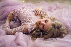 Young sexy blonde girl in Lacy pink dress Royalty Free Stock Photos