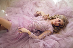 Young sexy blonde girl in Lacy pink dress Stock Photo